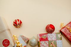 Holiday concept. Presents and christmas balls lying on each other. Green, red and golden colours.Top and side view.2019 new year. Christmas presents stock photo