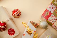 Holiday concept. Presents and christmas balls lying on each other. Green, red and golden colours.Top and side view.2019 new year. Christmas presents royalty free stock image