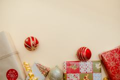 Holiday concept. Presents and christmas balls lying on each other. Green, red and golden colours.Top and side view.2019 new year. Christmas presents stock photos