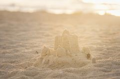 Holiday concept with sandcastle on the seaside Stock Images