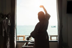Holiday concept Silhouette photo of woman posting relax action. Holiday concept Silhouette photo of woman posting relax action near a windows and outside is a Royalty Free Stock Images