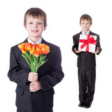 Holiday concept - two cute little boys twins in business suits w Royalty Free Stock Photo