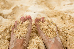 Holiday concept. Woman feet close-up relaxing on beach, enjoying sun and splendid view royalty free stock photos