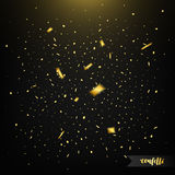 Holiday confetti on dark background with light. Golden confetti. Flying confetti Royalty Free Stock Photo