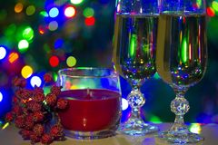 holiday congratulatory photo with cristal glasses and lights royalty free stock images