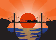 Holiday Convoy Suspension Bridge. A convoy of many holiday vehicles on a suspension bridge at sunset over the ocean Royalty Free Stock Image