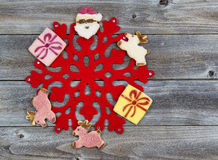 Holiday Cookie Decorations around Red Snowflake Royalty Free Stock Photography