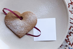 Holiday cookie heart shaped with paper note Stock Image