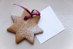 Holiday cookie star shaped with paper note Stock Images