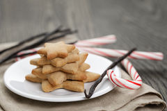 Holiday cookies and candy canes on wood table Stock Image