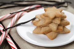 Holiday cookies and candy canes on wood table Royalty Free Stock Image