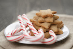 Holiday cookies and candy canes on wood table Stock Photography