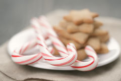 Holiday cookies and candy canes on wood table Stock Photo