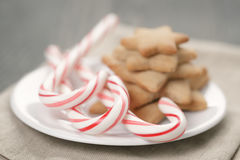 Holiday cookies and candy canes on wood table Stock Images
