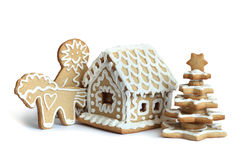 Holiday cookies. Christmas cookies in the shape of a house, tree, horse and man on white background Royalty Free Stock Photo
