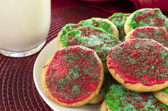 Holiday cookies. Plate of christmas sugar cookies with a glass of milk stock photography