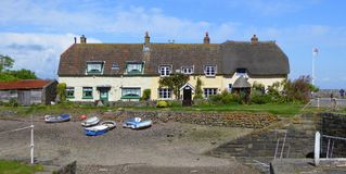 Holiday cottages by the side of a harbour. Historical watere cottages by a harbour at Porlock Weir in Somerset, England Stock Photo