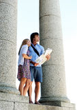 Holiday couple looks at map Royalty Free Stock Photo