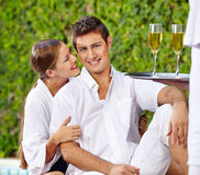 Holiday couple at pool with champagne Stock Photos