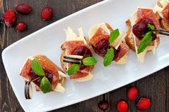 Holiday crostini appetizers with cranberry sauce, above view Stock Photos