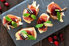 Appetizers with cranberry sauce above on a slate server Stock Image