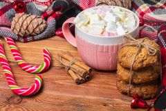 Holiday cup of cocoa with marshmallow or coffee with spice and home cookies. Christmas background Royalty Free Stock Photo