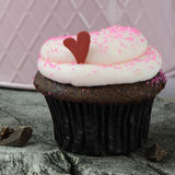 Holiday Cupcake with Heart On Wood Background Royalty Free Stock Photography