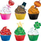 Holiday Cupcakes. Vector of six different Holiday Cupcakes. Christmas, Halloween, Thanksgiving, Valentines Day , Independence Day and St. Patricks Day Stock Images