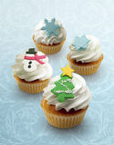Holiday cupcakes!. Cute winter cupcakes perfect for any winter holiday be it New Years, Christmas, or Hanukkah stock image