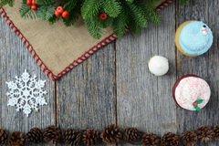 Holiday Cupcakes On Rustic Wood Background for the Holidays Stock Photography