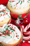 Holiday cupcakes with vanilla frosting, red and green sprinkles Stock Photography