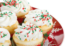 Holiday cupcakes with vanilla frosting, red and green sprinkles Royalty Free Stock Image