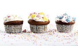 Holiday cupcakes on white background Stock Photos
