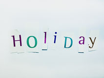 Holiday - Cutout Words Collage Of Mixed Magazine Letters with White Background. Caption composed with letters torn from magazines with White Background Stock Photos