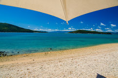 Holiday on Daydream Island. Beach with parasol on the beautiful Daydream Island Stock Photo