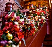 Holiday Decor Bannister. A beautiful ornament studded garland decorating this staircase bannister for the Christmas holiday season royalty free stock images