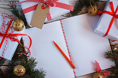Free Holiday Decor Notebook For Message With Gift, Present Box And Gold Jingle Bell. Christmas Background. Top View Stock Photos - 81926153
