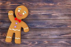 Holiday Decorated Classic Gingerbread Man Cookie. 3d Rendering. Holiday Decorated Classic Gingerbread Man Cookie on a wooden table. 3d Rendering royalty free illustration