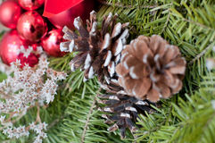 Holiday decoration. Fragment of an outdoor decoration with pine cones Stock Photos