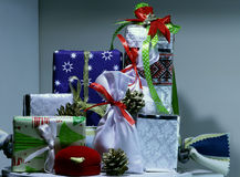 Holiday decoration. Colored boxes and cases for New Year gifts and presents. Different kind of Christmas gifts and presents in colored boxes detailed studio shot Royalty Free Stock Photo