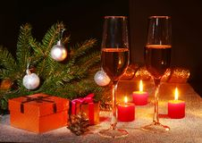 Holiday decoration with gift boxes, christmas candles, tree and colorful christmas balls. Selective focus. stock photo