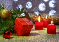 Holiday decoration with gift boxes, christmas candles, tree and colorful christmas balls. Selective focus. royalty free stock photos