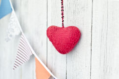 Holiday decoration. Red heart and multicolored flags Stock Image