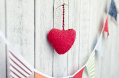 Holiday decoration. Red heart and multicolored flags Royalty Free Stock Image