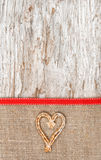 Holiday decoration with straw heart and burlap Stock Image