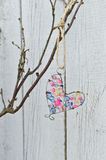 Holiday decoration. Wire heart hanging on a branch Royalty Free Stock Images