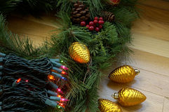 Holiday Decorations. Christmas tree lights, ornaments and pine branches ready to decorate for the holidays stock photography
