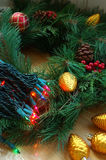 Holiday Decorations. Christmas tree lights, ornaments and pine branches ready to decorate for the holidays stock photos