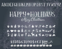 Holiday decorations and alphabet on a blackboard. Trendy hand-drawn Holiday decorations, alphabet and numbers on a blackboard royalty free illustration