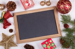 Holiday decorations and chalkboard Royalty Free Stock Images